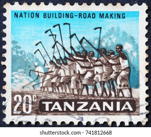 Milan, Italy - October 22, 2017: Workers on tanzanian postage stamp
