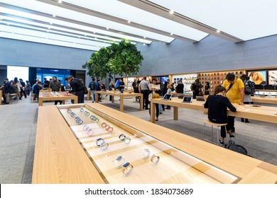 MILAN, ITALY - OCTOBER 22, 2018: People inside Apple Store - new retail store with modern design, opened at Piazza Liberty in Milan on July 26, 2018.