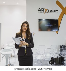 MILAN, ITALY - OCTOBER 22: Beautiful hostess at Smau, international exhibition of information communications technology on OCTOBER 22, 2014 in Milan.