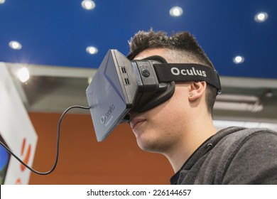 MILAN, ITALY - OCTOBER 24: Guy tries Oculus headset at Games Week 2014, event dedicated to video games and electronic entertainment on OCTOBER 24, 2014 in Milan.