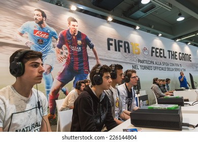 MILAN, ITALY - OCTOBER 24: Guys play at Games Week 2014, event dedicated to video games and electronic entertainment on OCTOBER 24, 2014 in Milan.