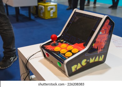 MILAN, ITALY - OCTOBER 24: Vintage Pac Man console at Games Week 2014, event dedicated to video games and electronic entertainment on OCTOBER 24, 2014 in Milan.