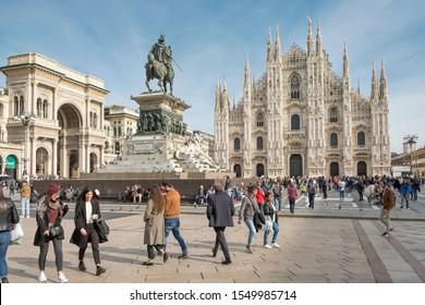 Milan, Italy - October 25,2019: People walking through the cathedral square in Milan.