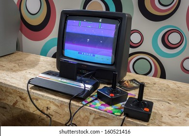 MILAN, ITALY - OCTOBER 26: Atari retro console at Games Week 2013, event dedicated to video games and electronic entertainment on OCTOBER 26, 2013 in Milan.
