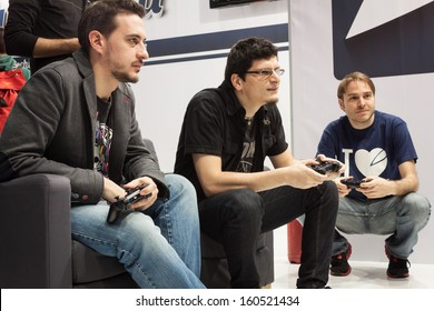 MILAN, ITALY - OCTOBER 26: People play at Games Week 2013, event dedicated to video games and electronic entertainment on OCTOBER 26, 2013 in Milan.