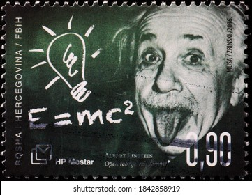 Milan, Italy - October 28, 2020: Famous picture of Einstein showing the tongue on postage stamp