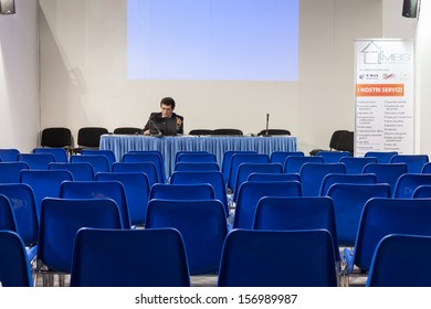 MILAN, ITALY - OCTOBER 3: A speaker prepares his lecture before people come at Made expo, international architecture and building trade show on OCTOBER 3, 2013 in Milan.