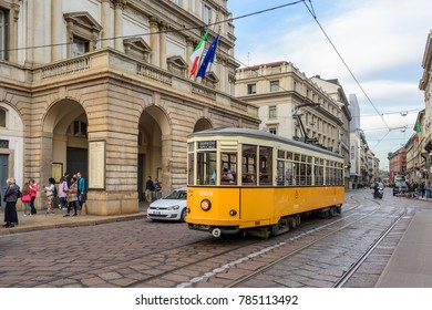 MILAN, ITALY - OCTOBER 30, 2017:  A public tram passing the La Scala opera house in central Milan.