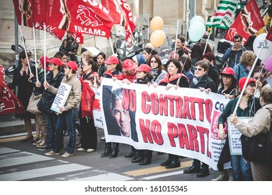 MILAN, ITALY - OCTOBER 31: National Strike of tourism in Milan on October, 31 2013. Thousands of tourism workers take the street to protest against layoffs and cutbacks in the tourism