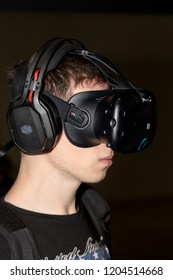 MILAN, ITALY - OCTOBER 5: A guy tries virtual reality headset Games Week 2018, event dedicated to video games and electronic entertainment on OCTOBER 5, 2018 in Milan.