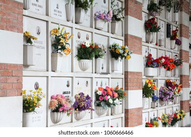 MILAN, ITALY - OCTOBER 6, 2010: Columbarium at Cimitero Monumentale in Milan, Italy. The Monumental Cemetery designed by the architect Carlo Maciachini is famous for its elaborate style.