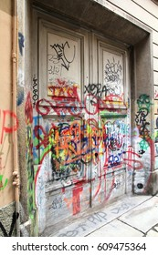 MILAN, ITALY - OCTOBER 7, 2010: Vandalism graffiti on a door in Milan, Italy. Milan is the 2nd largest city in Italy.