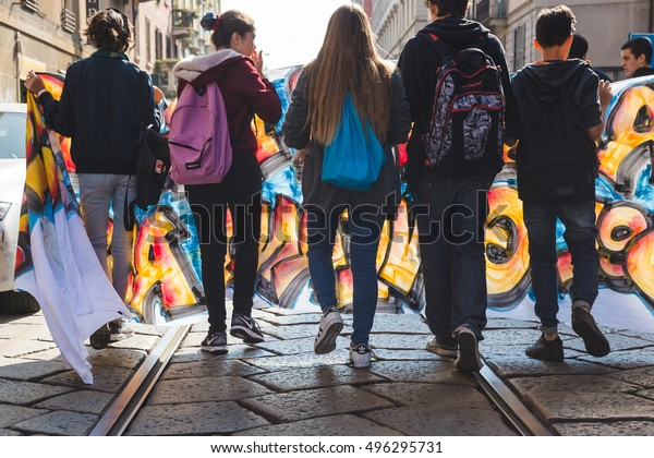 MILAN, ITALY - OCTOBER 7, 2016: Students march in the city streets to protest against the policy of the government on the school and the constitutional reform.