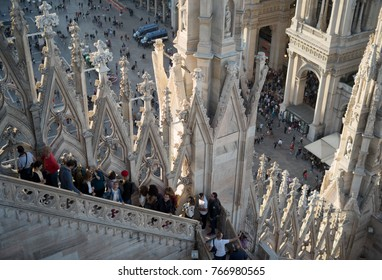 Milan, Italy - October 7, 2017: Tourists visiting the roof of famous Milan Cathedral