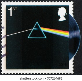 "Milan, Italy - September 1, 2017: Famous cover of Pink Floyd record ""The dark side of the moon"" on british stamp."