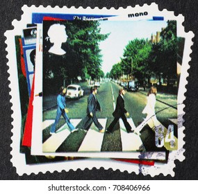 Milan, Italy - September 1, 2017: The Beatles crossing Abbey Road on postage stamp
