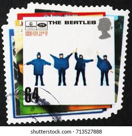 Milan, Italy - September 1, 2017: Famous record cover by Beatles on british stamp
