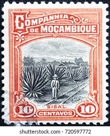 Milan, Italy - September 1, 2017: Agave plantation on old stamp of Mozambique