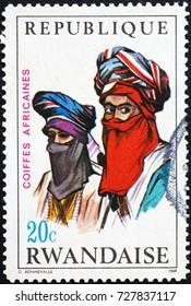 Milan, Italy - September 1, 2017: Tuareg men on postage stamp of Rwanda