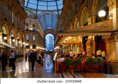 MILAN, ITALY - SEPTEMBER 11: Galleria Vittorio Emanuele II on September 11, 2013 in Milan. It's one of the world's oldest shopping malls, designed and built by Giuseppe Mengoni between 1865 and 1877.