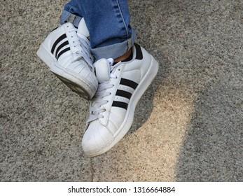 Milan, Italy - September 15, 2018: Adidas Superstar shoes in the street - illustrative editorial