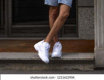 Milan, Italy - September 16, 2018: Man wearing a pair of Fila Disruptor shoes in the street