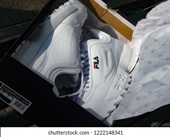 Milan, Italy - September 16, 2018: brand new, in of the box Fila Disruptor shoes in the street