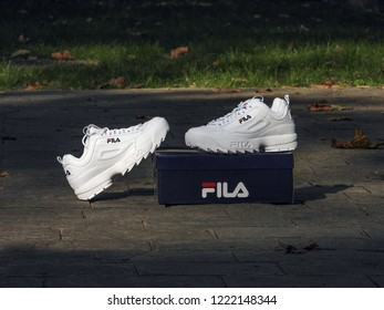 Milan, Italy - September 16, 2018: brand new, out of the box Fila Disruptor shoes in the street