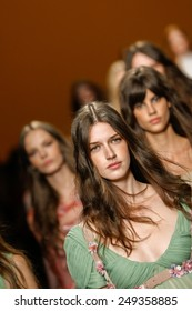 MILAN, ITALY - SEPTEMBER 17: Models walk the runway finale during the Alberta Ferretti show as part of Milan Fashion Week Womenswear Spring/Summer 2015 on September 17, 2014 in Milan, Italy.
