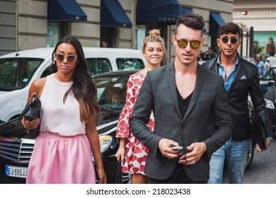 MILAN, ITALY - SEPTEMBER 17: People outside Gucci fashion shows building for Milan Women's Fashion Week on SEPTEMBER 17, 2014 in Milan.