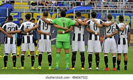 MILAN, ITALY SEPTEMBER 18, 2016: FC Juventus soccer team players embrace before the italian serie A match FC Internazionale vs FC Juventus, at the san siro stadium, in Milan.