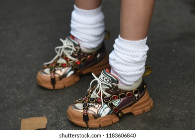 Milan, Italy - September 19, 2018: Street style outfits before JIL SANDER fashion show during Milan Fashion Week - Gucci fancy shoes  - MFWSS19
