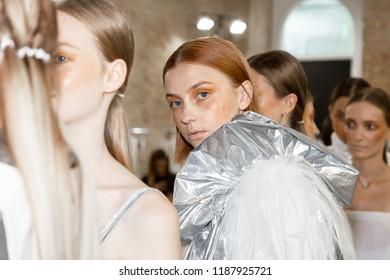 MILAN, ITALY - SEPTEMBER 19: Beautiful model poses in the backstage just before Alberto Zambelli show during Milan Women's Fashion Week on SEPTEMBER 19, 2018 in Milan.