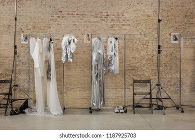 MILAN, ITALY - SEPTEMBER 19: Clothes on racks in the backstage just before Alberto Zambelli show during Milan Women's Fashion Week on SEPTEMBER 19, 2018 in Milan.