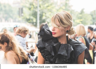 MILAN, ITALY - SEPTEMBER 19: Fashionable woman poses outside BYBLOS fashion show during Milan Women's Fashion Week on SEPTEMBER 19, 2018 in Milan.