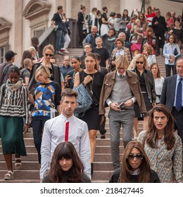 MILAN, ITALY - SEPTEMBER 19: People outside Marco De Vincenzo fashion shows building for Milan Women's Fashion Week on SEPTEMBER 19, 2014 in Milan.