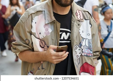 MILAN, ITALY - SEPTEMBER 20, 2018: Man with beige jacket with Hello Kitty design before Vivetta fashion show, Milan Fashion Week street style