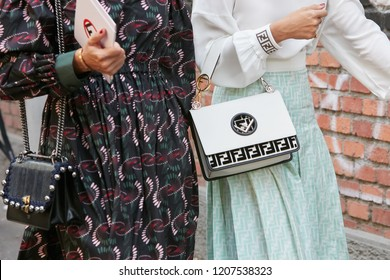 MILAN, ITALY - SEPTEMBER 20, 2018: Women with black and white Fendi bags before Fendi fashion show, Milan Fashion Week street style