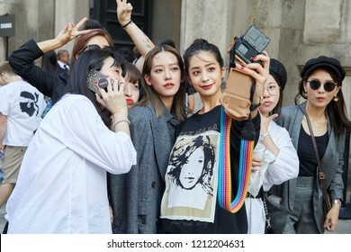 MILAN, ITALY - SEPTEMBER 20, 2018: Women shooting selfies photos before Max Mara fashion show, Milan Fashion Week street style