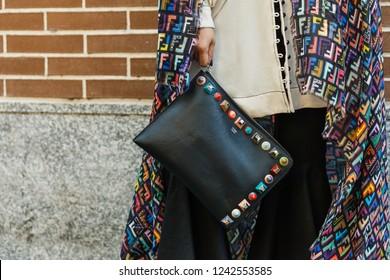 MILAN, ITALY - SEPTEMBER 20, 2018: Fashionable woman holding bag before FENDI fashion show at Milan Fashion Week Spring/Summer 2019.