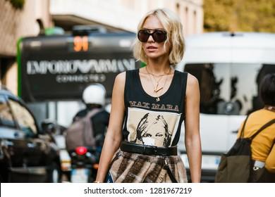 MILAN, ITALY - SEPTEMBER 20, 2018: A guest before FENDI fashion show at Milan Fashion Week Spring/Summer 2019.