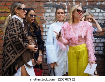 MILAN, Italy- SEPTEMBER 20: Fashion bloggers posing for photographers in the street after FENDI fashion show, during Milan Fashion Week spring/summer 2019 on September 20, 2018.