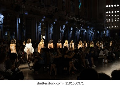 MILAN, ITALY - SEPTEMBER 20: Gorgeous models walk the runway at Genny show during Milan Women's Fashion Week on SEPTEMBER 20, 2018 in Milan.