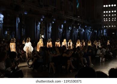 MILAN, ITALY - SEPTEMBER 20: Gorgeous models walk the runway at Genny show during Milan Women's Fashion Week on SEPTEMBER 20, 2018 in Milan.