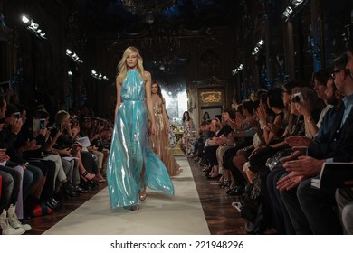 MILAN, ITALY - SEPTEMBER 20: Models walk the runway finale during the Genny show as part of Milan Fashion Week Womenswear Spring-Summer 2015 on September 20, 2014 in Milan, Italy.