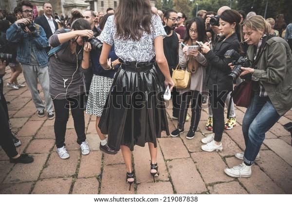 MILAN, ITALY - SEPTEMBER 20: People during Milan Fashion week in Milan, Italy on September, 20 2014.professional photographers in the outside city during Milan fashion week shooting eccentric people