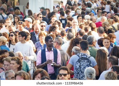 Milan, Italy - September 2016: crowd of people in the main street of a market