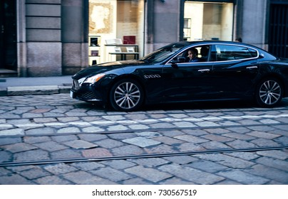 Milan, Italy - September 2017: A man is riding in Maserati down the street