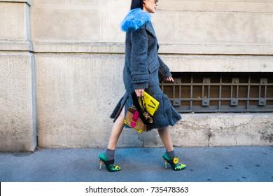 MILAN, ITALY - SEPTEMBER 21, 2017: woman attending fashion show during Milan Fashion Week Women Spring/Summer 2017/2018