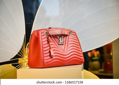 Milan, Italy - September 21, 2018: Louis Vuitton store in Milan. Montenapoleone area. Fashion week Louis Vuitton shopping.